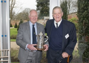 Tony Garnett receives the cup from Sir William Bromley Davenport KCVO