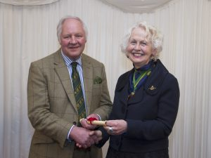 Tony Garnett receiving his Fellowship from the Chairman of the Society, Rosie Carne at the House of Lords.